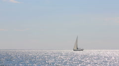 Sailboat Slowly Floating In The Sea Stock Footage