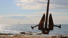 Black Anchor Swinging At Seaside Stock Footage
