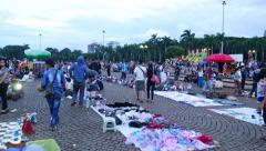 Flea market on ground, Merdeka Square in weekend evening, glide shot Stock Footage