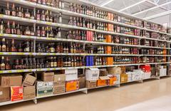 Showcase alcoholic beverages at the hypermarket Auchan Stock Photos