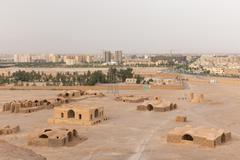 View to the Zoroastrian temples ruins and Yazd city from the Tower of Silence Stock Photos