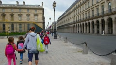 Pupils of beginner grade walking on excursion near Louvre museum. Stock Footage