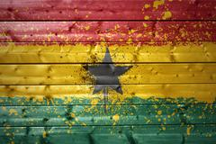 painted ghanaian flag on a wooden texture - stock photo