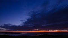 Blue orange sky in a midsummer night at the coast of Torekov in Sweden - stock footage