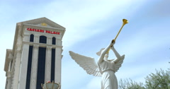 Winged Roman statue blows horn outside of Caesars Palace, Las Vegas Stock Footage