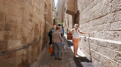 Stock Video Footage of 4K Tourists in Alleyway