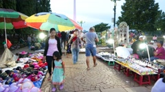 Rush through flea market at Merdeka Square park, Monas on background Stock Footage