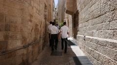 4K Passerby in Jerusalem Old City Alleyway Stock Footage