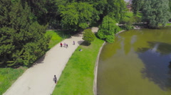 PARIS, POV, walking in park Buttes-Chaumont, steadicam. Stock Footage
