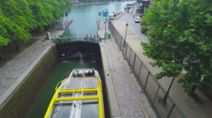PARIS, ship docking in floodgate in channel, steadicam. Stock Footage