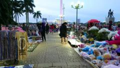 Move through unofficial weekend market, Merdeka Square, glide shot Stock Footage