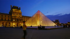 PARIS, FRANCE, Louvre museum at dusk, tourists, time-lapse in motion, hyperlapse - stock footage