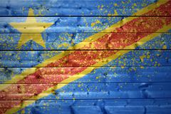 Painted democratic republic of the congo flag on a wooden texture Stock Photos