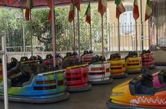 Bumper cars in a fairground - stock photo