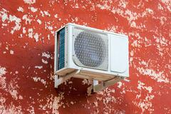 Air conditioning heat pump mounted on the wall Stock Photos