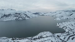 Aerial shot of a water reservoir during winter Stock Footage