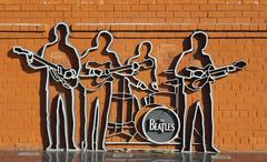 The Beatles monument with a brick wall Kuvituskuvat