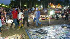Bright vibrant view of flea market in night time, Merdeka Square, glide camera Stock Footage