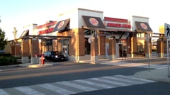 One side of  Burger King drive thru and front door Stock Footage