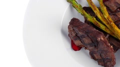 Meat barbecue steak fillet with asparagus Stock Footage