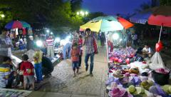 Night view, unofficial market at Merdeka Square, camera walks along passway Stock Footage