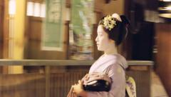 Geisha entering a tea house in Kyoto Stock Footage