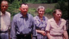2232 - family members line up for photo at reunion - vintage film home movie Stock Footage