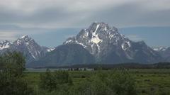 Grant Teton Mountain range meadow lake glacier 4K 06 Stock Footage