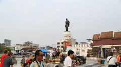 Tourists visit Thao Suranaree statue Stock Footage