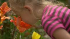 Cute Girl Smelling Fower Stock Footage