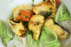 Fried fish rice noodle soup Stock Photos