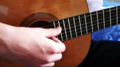 Young Man Playing A Guitar Solo Stock Footage
