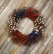 Stock Photo of Independence Day wreath on rustic wooden boards