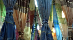 Market Display Of Silk Curtains Stock Footage