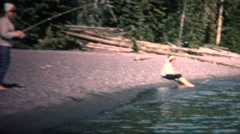 (8mm Vintage) 1968 Women Catching Fish Long Pole Shore Stock Footage