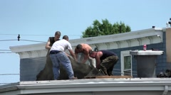 Roofers remove old rooftop from house. Stock Footage