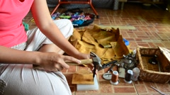 Thai woman punching hole on leather for made  handmade bag leather Stock Footage