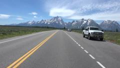 Driving POV towards Grand Teton NP Mountains fast motion 4K 052 Stock Footage