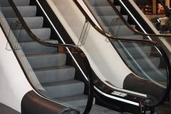 The escalator in shopping center Stock Photos
