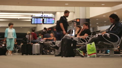 Passengers wait for delayed flight Stock Footage