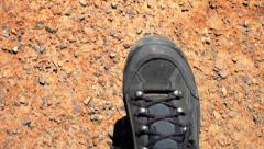 Hiking across cracked desert landscape. Slow motion. Global warming concept Stock Footage