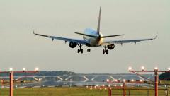 Commercial Jet Landing at Dusk, Rear View. Stock Footage