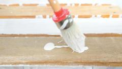 Painting old wooden furniture with a brush  Stock Footage