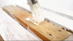 Painting old wooden furniture with a brush 3 Stock Footage