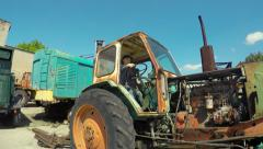 Boy playing on old tractor Stock Footage