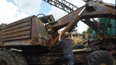 Boy playing on old tractor - stock footage