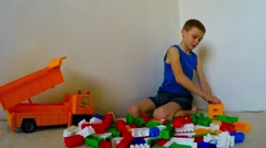 Children play a designer build a house. Taymlaps Stock Footage