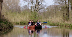 Group of boys fun with canoeing Stock Footage