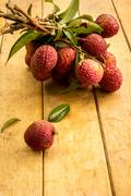 Lychee, ripe red table ready to eat. - stock photo