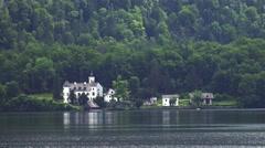 4k Castle at mountain forest lake Hallstatt in Austria Stock Footage